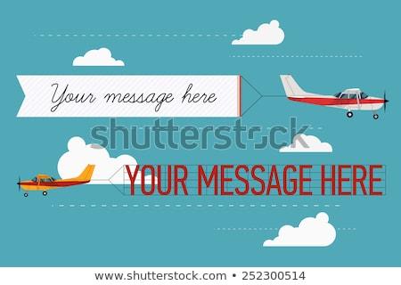 klein · propeller · vliegtuig · banner · hemel · bewolkt - stockfoto © studioworkstock