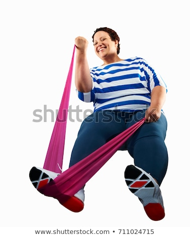 Large woman using resistance band Stock photo © IS2