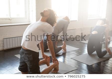 group of people doing camel pose at yoga studio Stock photo © dolgachov