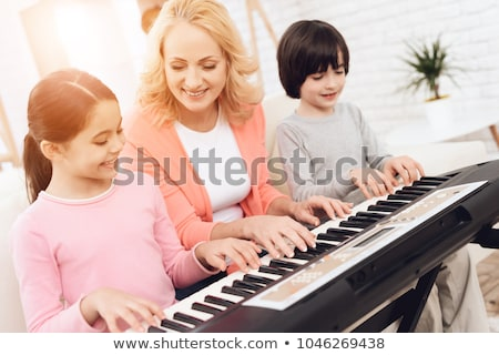 Grandmother and grandson playing the piano Stock photo © IS2