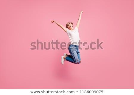 Trampolim menina saltar menina feliz saltando Foto stock © FOTOYOU