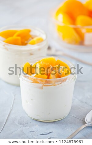 Iogurte orgânico pêssego casal primavera comida Foto stock © mpessaris