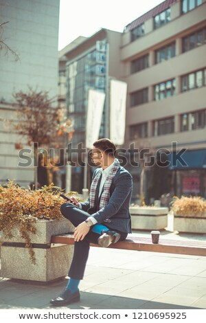 portrait of handsome man holding his sunglasses and thinking stock photo © feedough