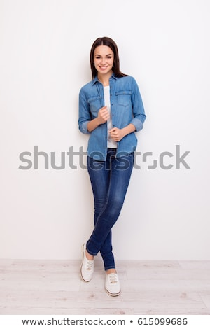 full length image of cheerful brunette woman in casual clothes stock photo © deandrobot