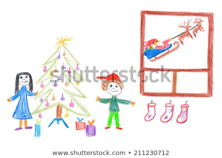 man and woman handing out gifts under christmas tree stock photo © kzenon