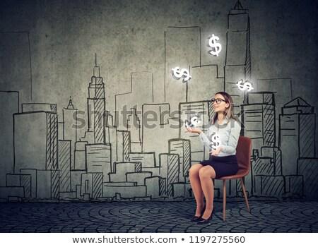 Zakenvrouw jongleren dollar symbolen stadsgezicht valuta Stockfoto © ichiosea