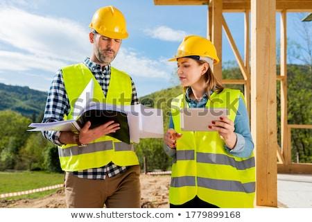Supervisor edificio planes trabajadores Foto stock © diego_cervo