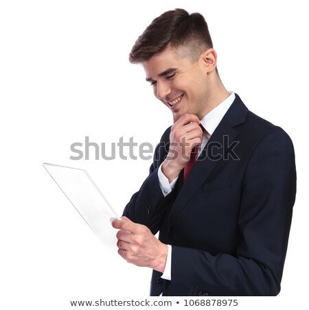 portrait of curious smart casual man wearing navy suit thinking Stock photo © feedough