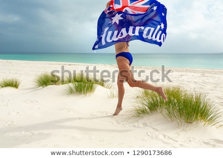 aussie woman running along the beach australian pride stock photo © lovleah