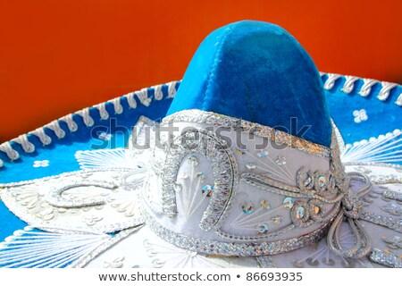 charro mariachi blue mexican hat detail over orange Stock photo © lunamarina