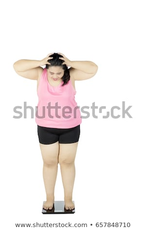 Full length portrait of an upset overweight young woman Stock photo © deandrobot