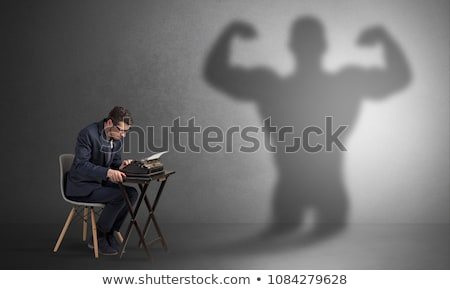 Hard worker afraid of scary monster Stock photo © ra2studio