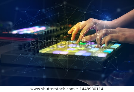 Stock photo: Hand mixing music on midi controller with play music and multimedia concept
