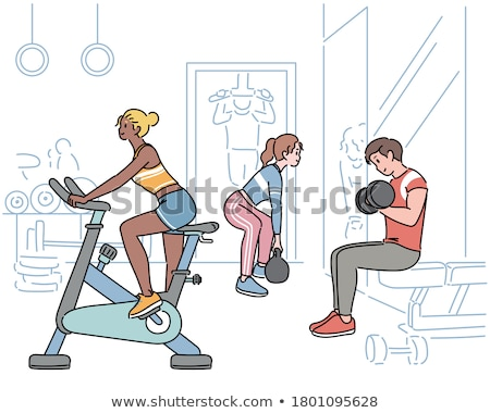people exercising at fitness center stock photo © kzenon