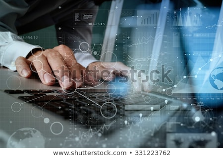 Hand typing on laptop with online finance management concept Foto stock © ra2studio