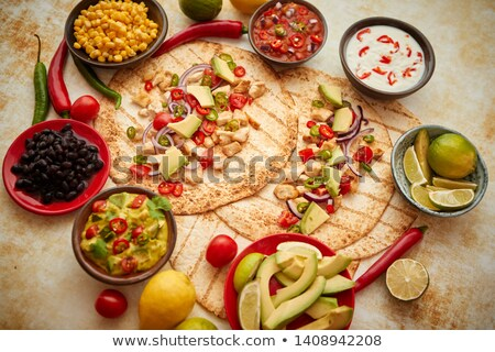 Freshly made healthy corn tortillas with grilled chicken fillet, big avocado slices Stock photo © dash