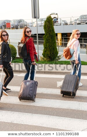 Photo of three happy girls smiling while traveling abroad togeth Stock photo © deandrobot