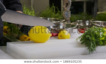 Picado limão faca tabela comida Foto stock © dolgachov