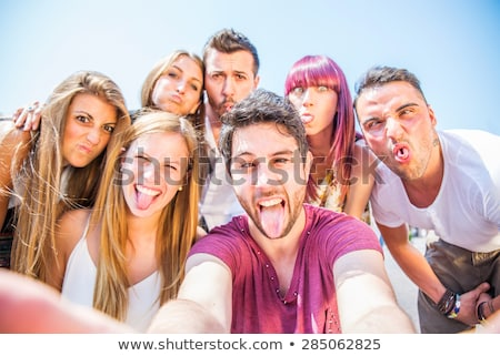 Cheerful college friends looking in camera while making selfie Stock photo © pressmaster