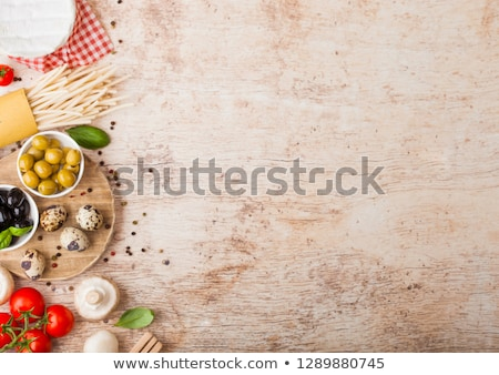 homemade spaghetti pasta with quail eggs with bottle of tomato sauce on wooden background classic i stock photo © denismart