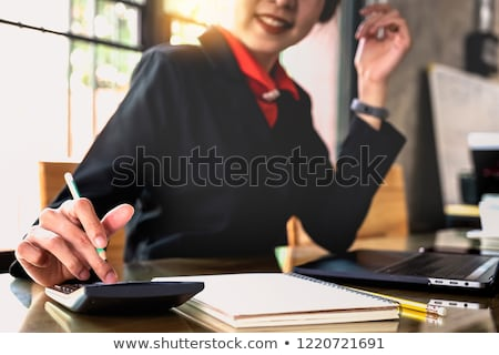 Business woman doing analysis Stock photo © ra2studio