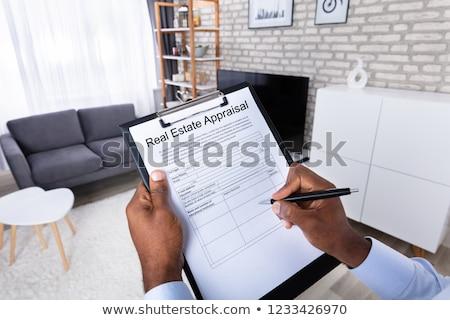 Férfi tömés ingatlan értékbecslés űrlap közelkép Stock fotó © AndreyPopov