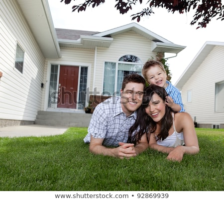portrait of happy family lying down in grass stock photo © lopolo