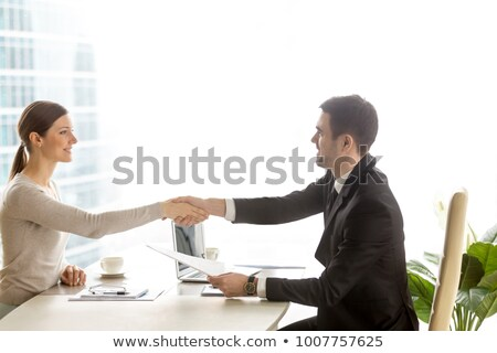 Businessman Interviewing Female Applicant Stock photo © AndreyPopov