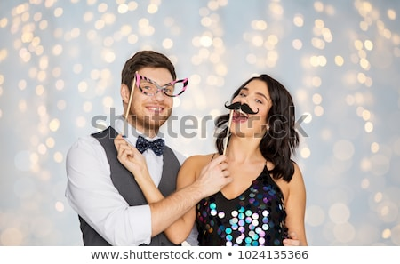 couple with party props having fun and posing Stock photo © dolgachov