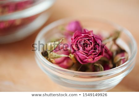 Dry pink rosebud in small glassware that can be used in process of soap making Stock photo © pressmaster