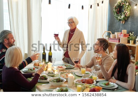 улыбаясь старший женщину стекла Сток-фото © pressmaster