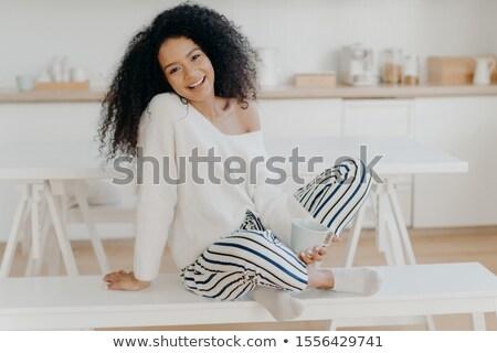 Satisfecho jóvenes compañera afro rizado peinado Foto stock © vkstudio