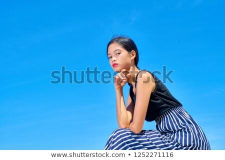Femme longtemps cheveux noirs séance Rock Photo stock © ElenaBatkova
