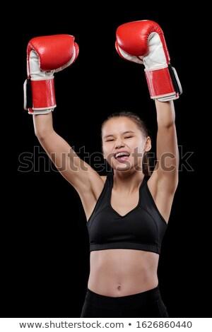 Jovem extático luvas de boxe triunfo Foto stock © pressmaster