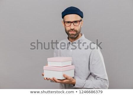 Fotó komoly férfi modell ünnepi ruházat ajándékok Stock fotó © vkstudio