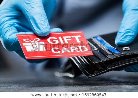 Consumer Taking Gift Card From Wallet In Gloves Stock photo © AndreyPopov