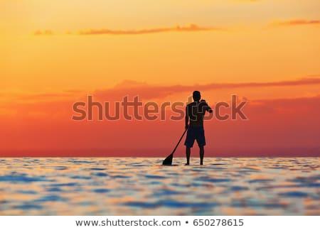 Egészséges fiatal srác tanul szörf tenger óceán Stock fotó © galitskaya
