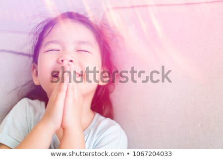 Adorable little girl praying Stock photo © ilona75