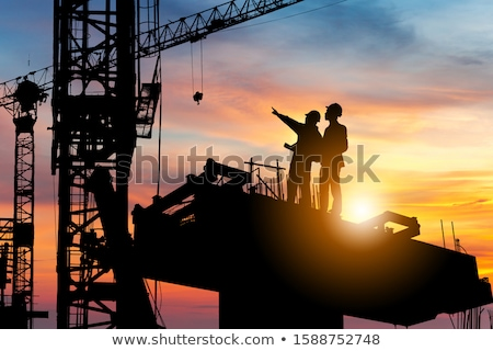 construction site with crane and workers stock photo © deyangeorgiev