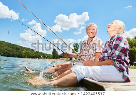 Pareja · río · mujer · agua · peces - foto stock © photography33
