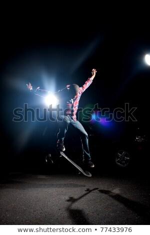 Skateboarder springen dramatischen Beleuchtung niedrig Schlüssel Stock foto © ArenaCreative