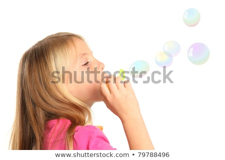 Portrait female face and soap bubbles isolated on white stock photo © jagston