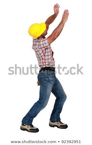 Tradesman lifting an invisible object Stock photo © photography33
