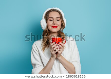 Winter portrait of a blue-eyed girl holding cup of tea stock photo © MilosBekic