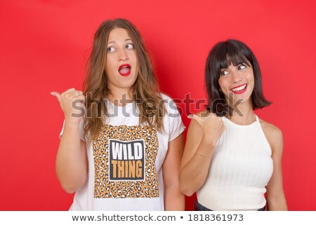 Two strange women posing Stock photo © konradbak