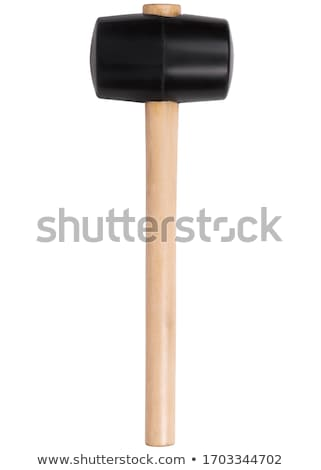 Stock photo: Adjusting wall with wooden mallet