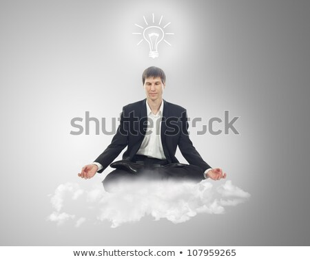 Businessman in lotus position on a cloud with a light bulb over  Stock photo © vlad_star