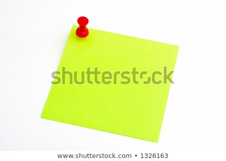 Isolated green paper with red pushnail stock photo © broker