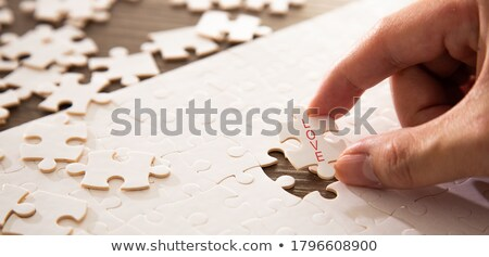 Mother and daughter completing jigsaw stock photo © photography33