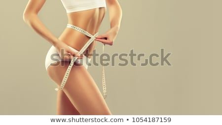 Stock photo: Young Beautiful Woman Measuring Her Hip. Perfect Slim Body